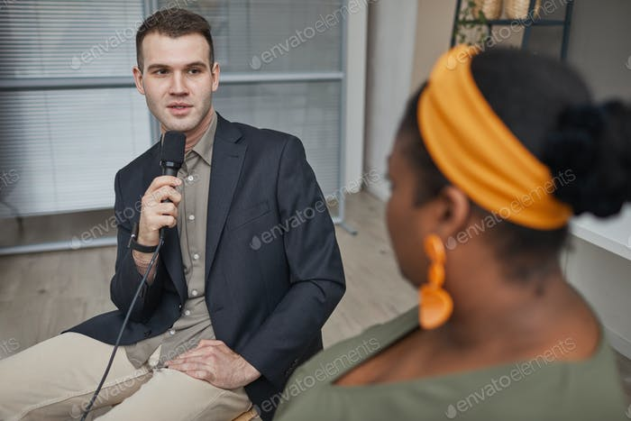 TV reporter taking an interview