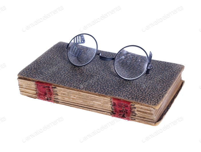 Old Circular Glasses on Ancient Book