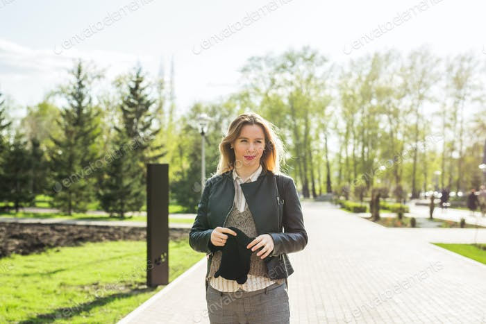 Stylish pregnancy concept. Portrait of happy pregnant woman in trendy clothing. Casual style.