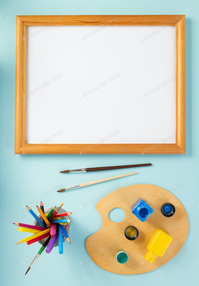 picture frame and paints on abstract background