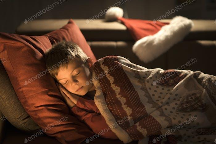 Boy waiting for Santa on Christmas eve