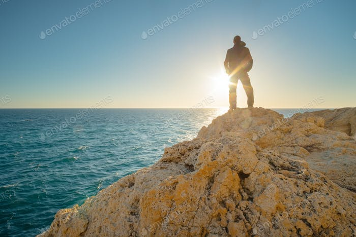 Man stands on the edge of the abyss