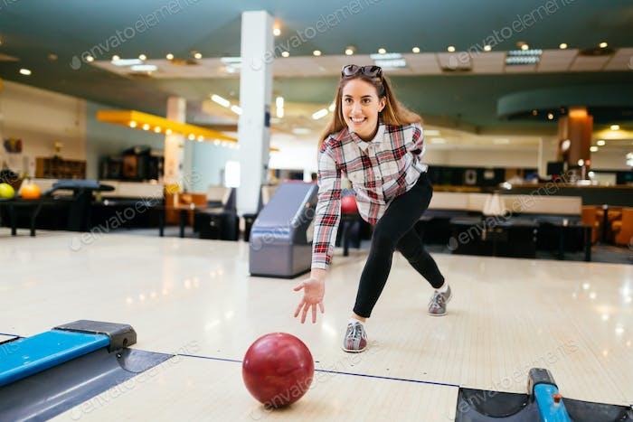 Beautiful woman bowling