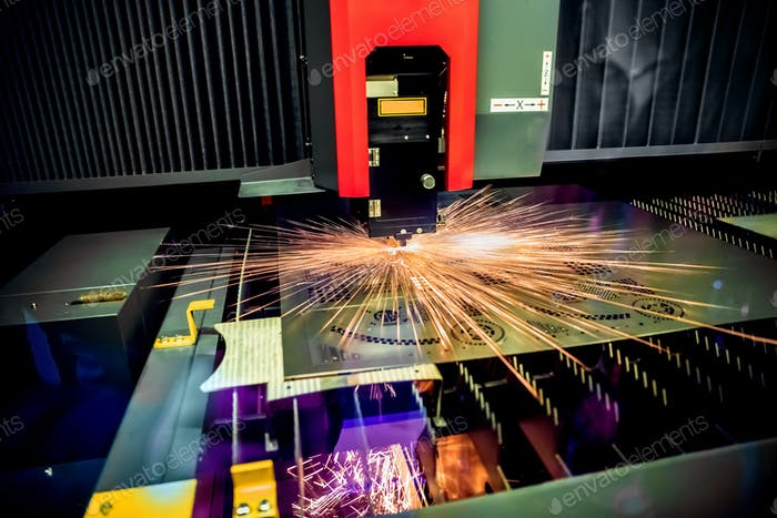 CNC Laser cutting of metal, modern industrial technology.