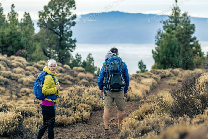Couple hiking with baby boy travelling in backpack