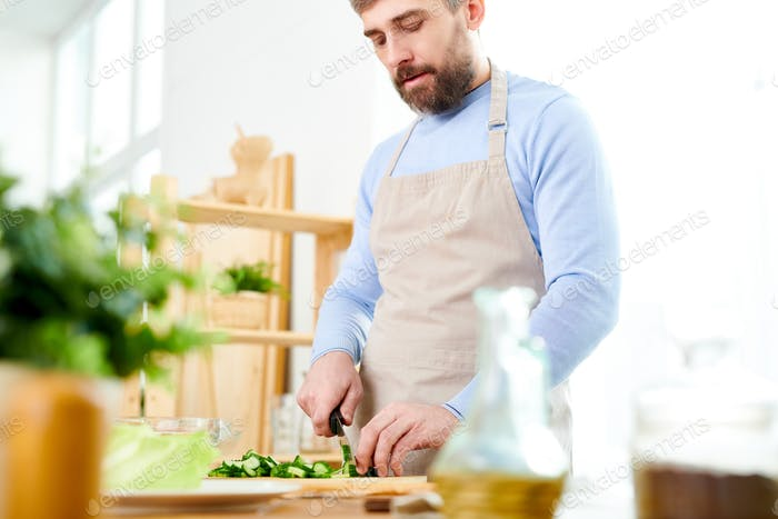Husband Cooking at Home