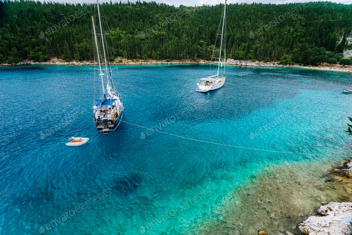 Crystal clear transparent blue turquoise teal mediterranean sea water of Foki Fiskardo Beach with