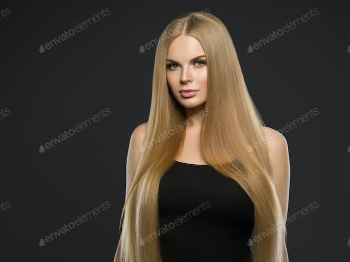 Beautiful blonde woman hairstyle long smooth curly hair fashion makeup