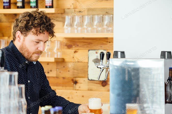 Man holding glass with froth beer