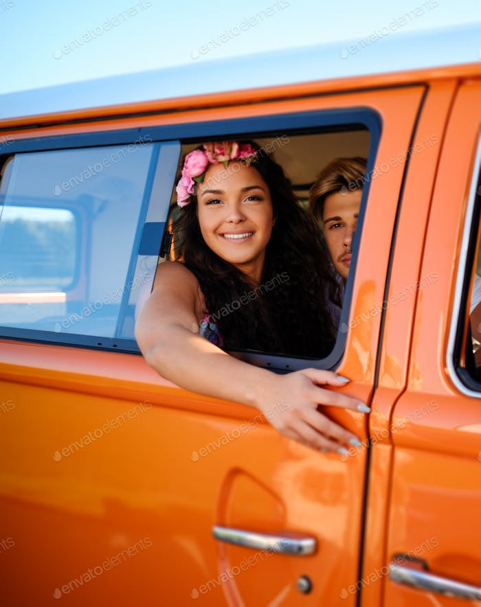 Beautiful hippie girl in a van