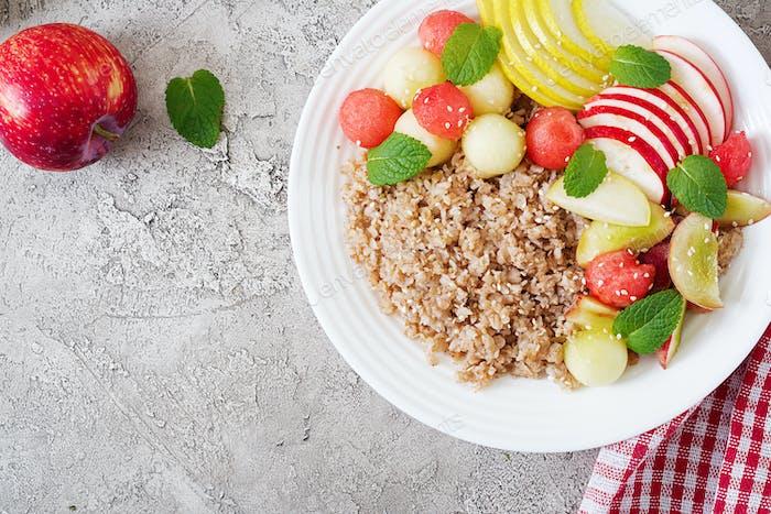 Buckwheat or porridge with fresh melon, watermelon, apple and pear