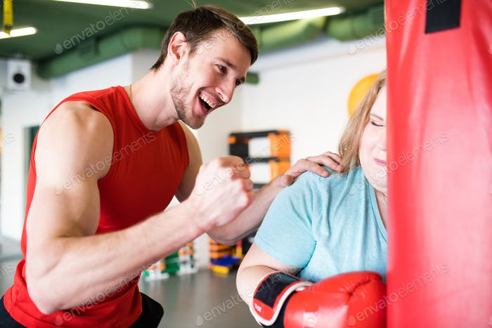 Personal Fitness Trainer Motivating Client