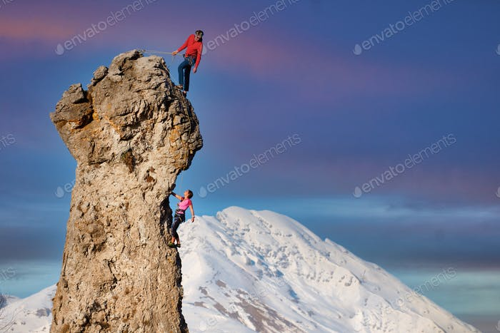Male and female rock climbers