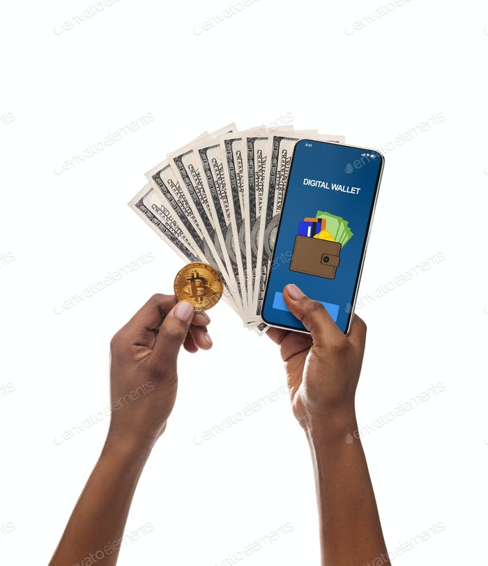 Black woman's hands holding BTC coin, smartphone and dollar cash