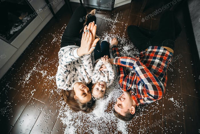Happy family playing together on the floor