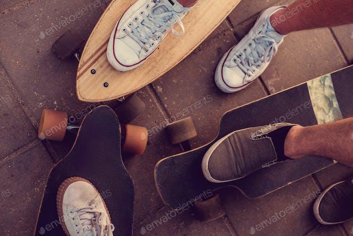 Skaters legs on Longboards.
