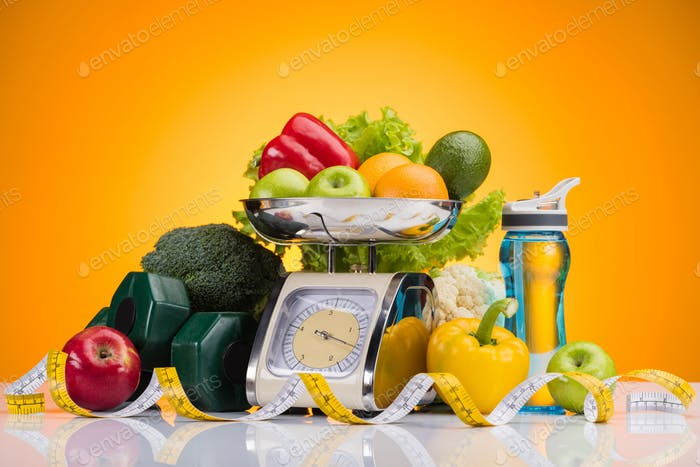 close-up view of fresh fruits and vegetables on scales, sports bottle with water, dumbbells and