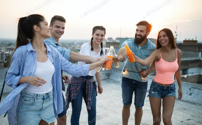 Friends having party on top of the roof. Fun, summer, city lifestyle and friendship concept