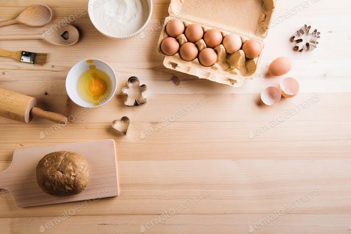 Baking ingredients and kitchen utensils. Wooden backround. Copy