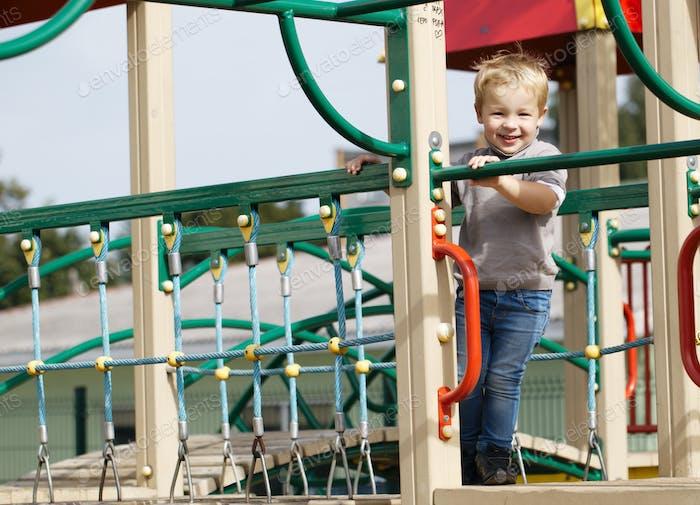 Boy on playground equipment