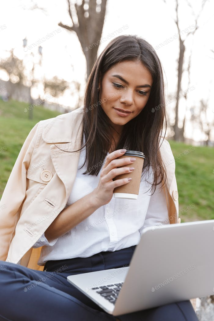 Attractive young woman using laptop computer