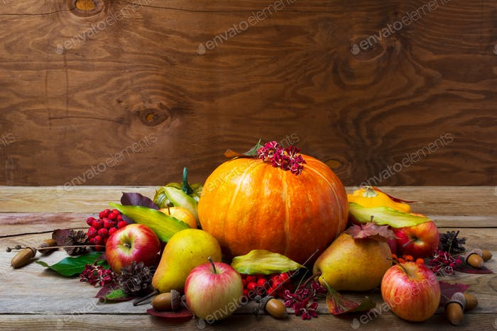 Thanksgiving table centerpiece with pumpkin, apples, pears, copy