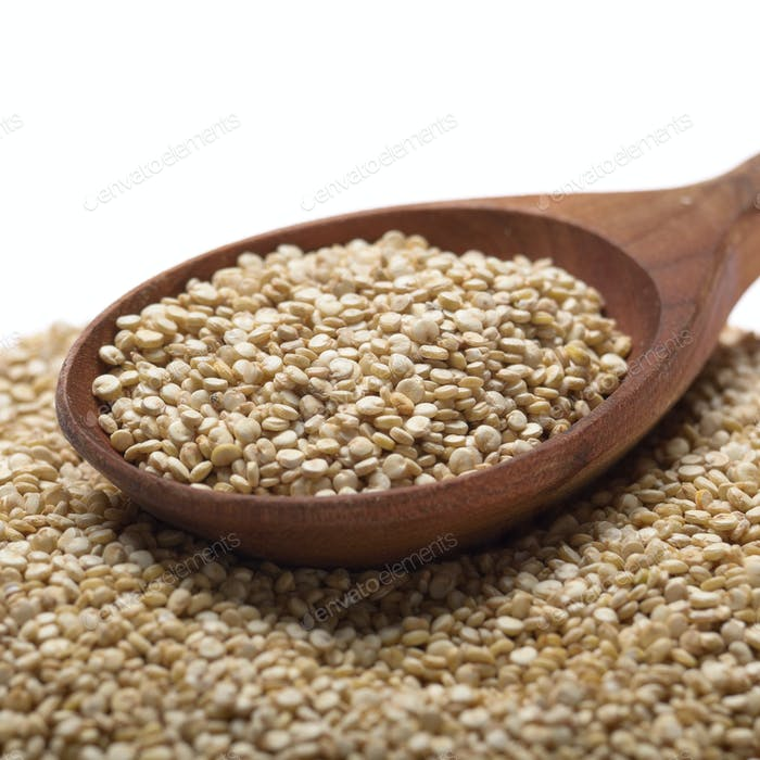 Raw organic superfood gluten free quinoa seeds in wooden spoon c