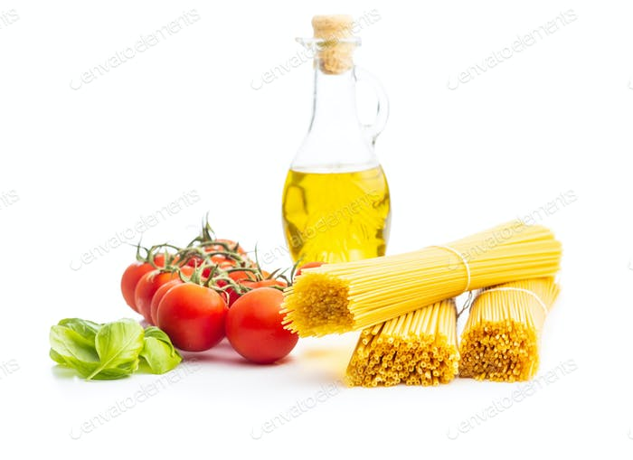 Raw spaghetti pasta, cherry tomatoes, basil leaves and olive oil.