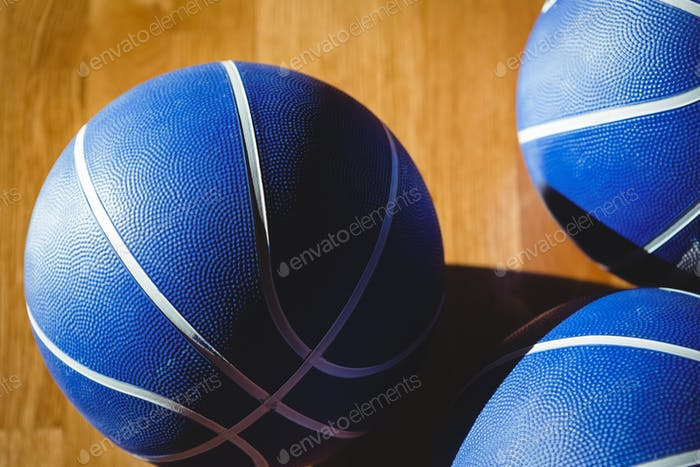 Close up of blue basketballs in court