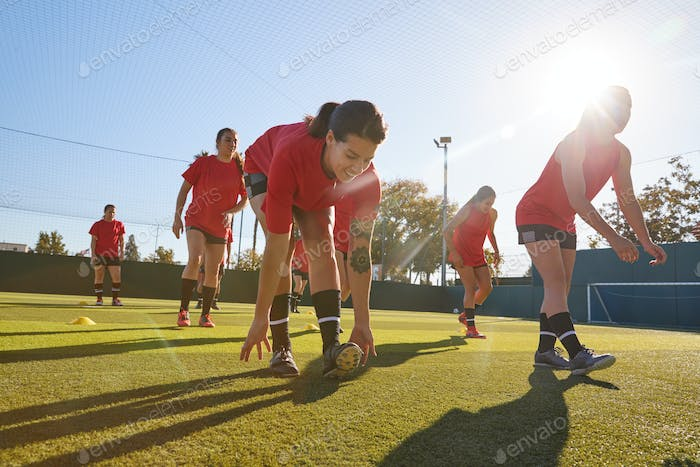 Womens Football Team Training For Soccer Match On Outdoor Astro Turf Pitch