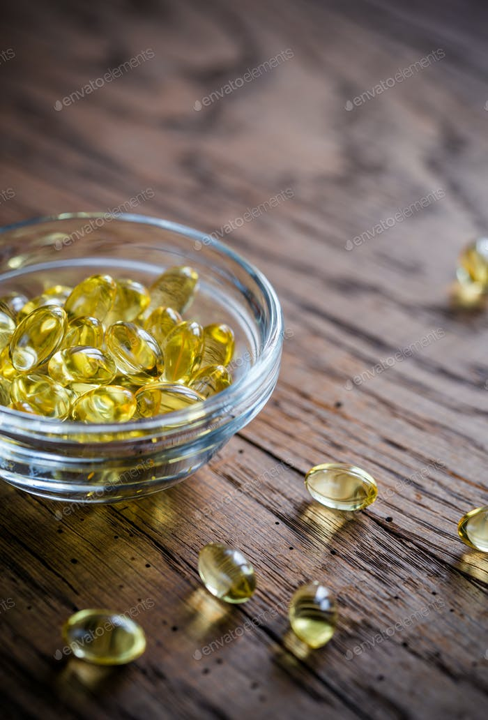 Omega-3 capsules in the glass bowl