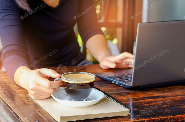 Business people working laptop with coffee on table.