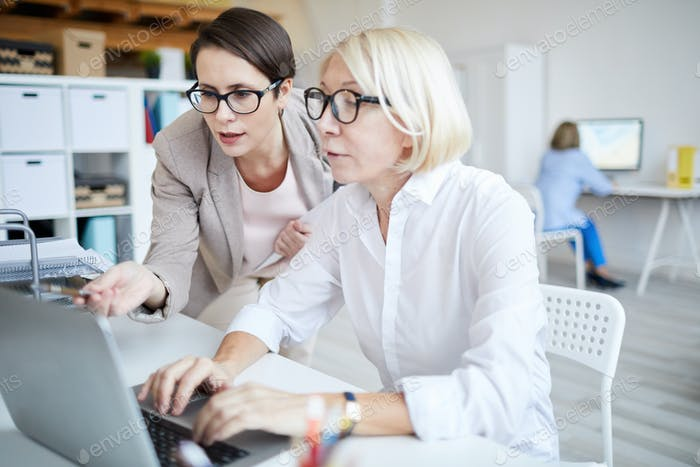 Two Modern Businesswomen Working