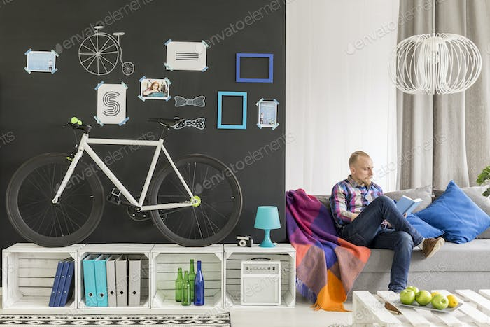 Blond student in his room