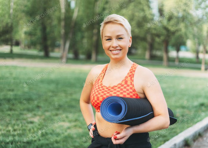 Attractive young woman enjoy sport in park