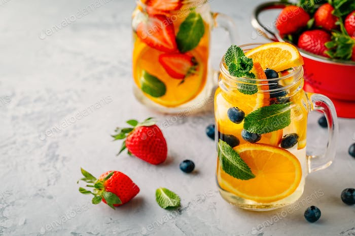 Infused detox water with orange, blueberry, strawberry and mint.