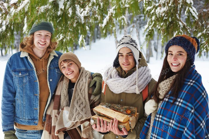 Young People in Winter Forest