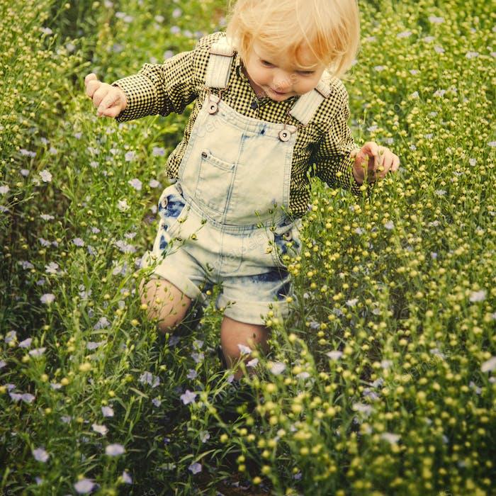 Kid in flower field