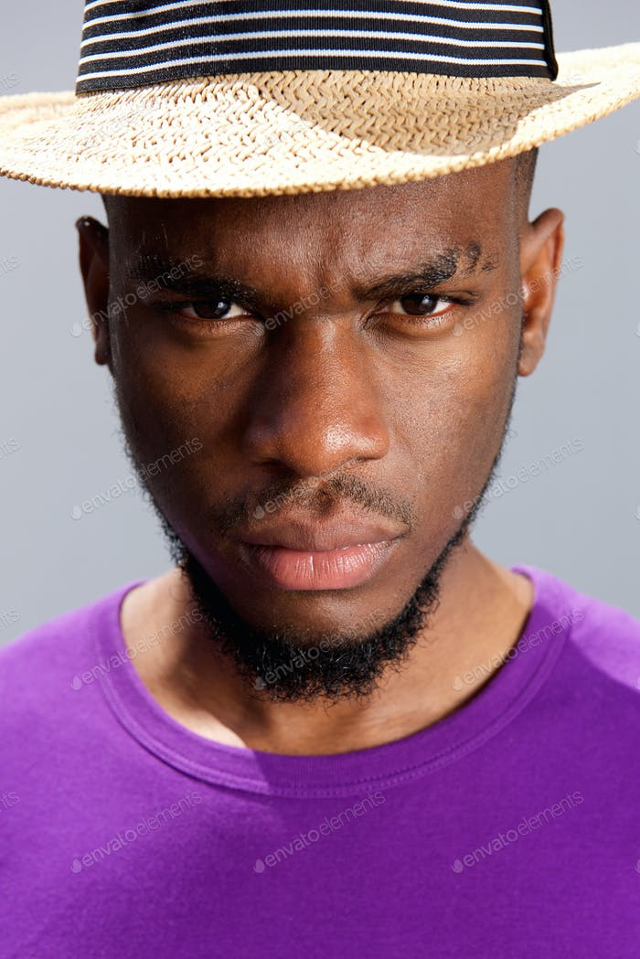 Young black man with serious expression on face