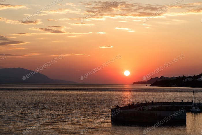 Beautiful sunset with sea and pier in Loutraki, Grecee