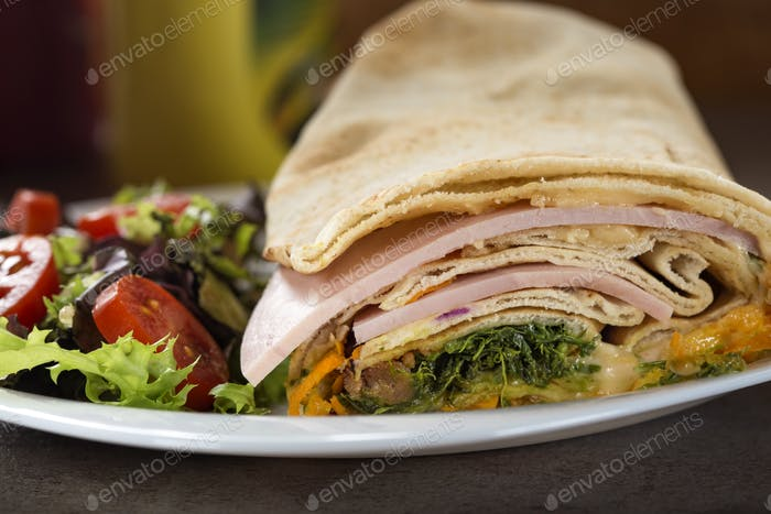 Sandwich or wrap filled with pork and beef meat