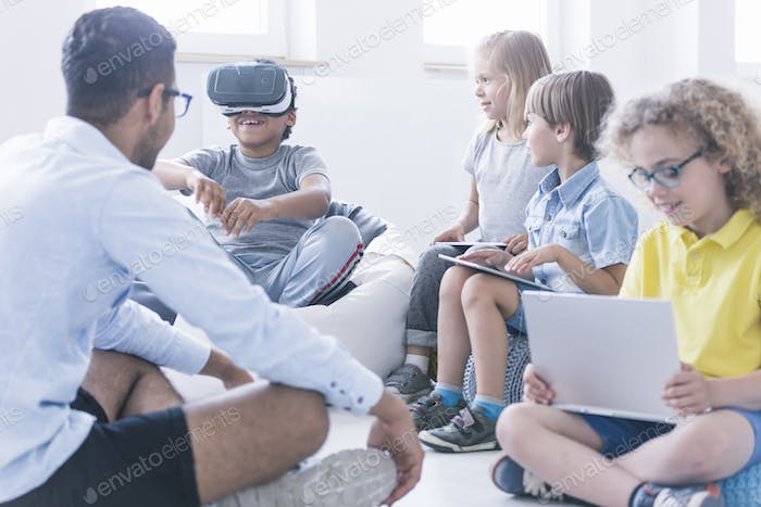 Boy uses VR glasses