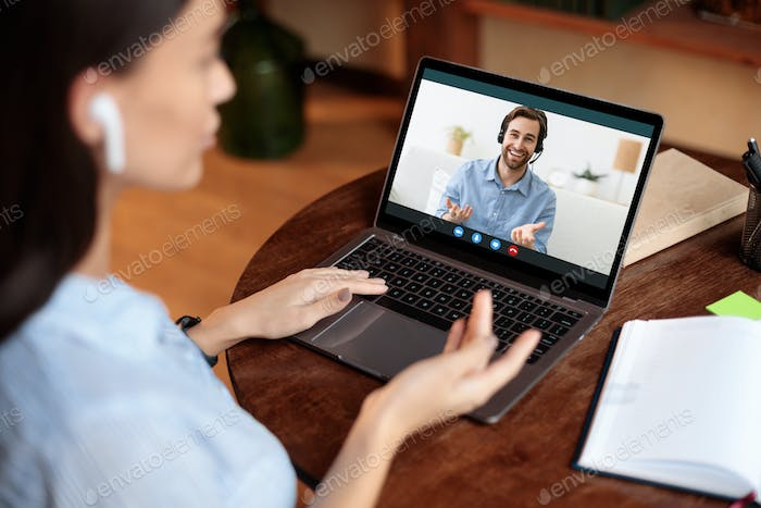 Woman using laptop and making video call with boss