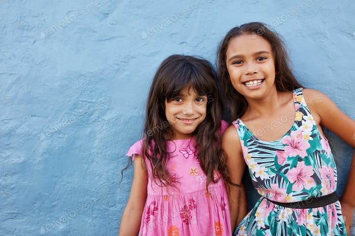 Adorable little girls posing together with cute smile