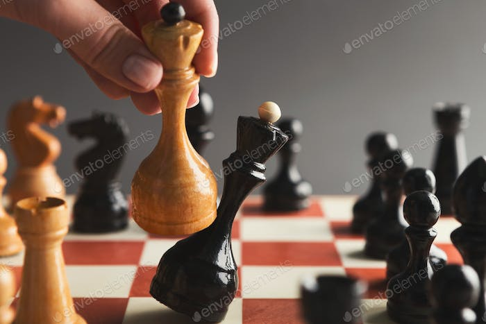 Hand take checkmate on chessboard during game