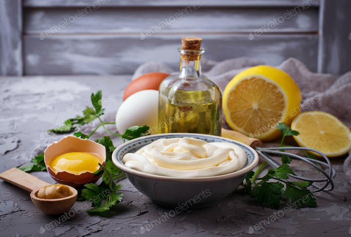 Homemade mayonnaise sauce and olive oil, eggs, mustard, lemon