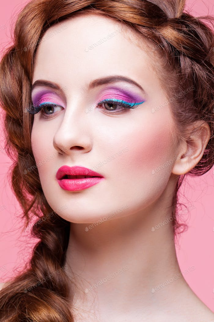 Beautiful girl with bright make-up