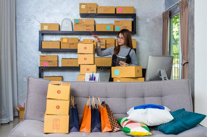 asian teenager owner business people work at home for online shopping, checking the order