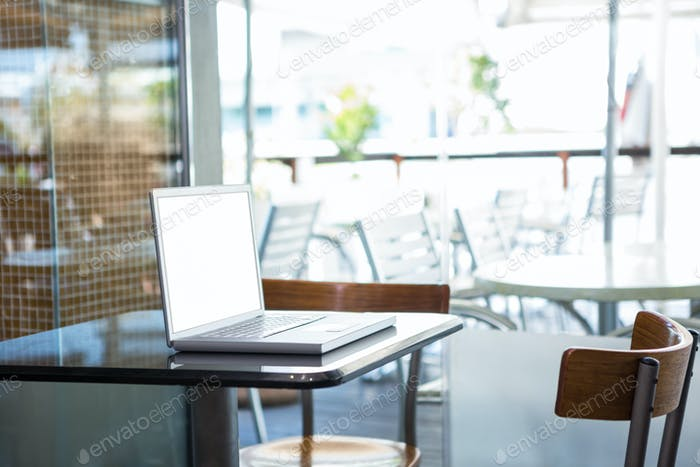 Laptop on a table in a coffee shop