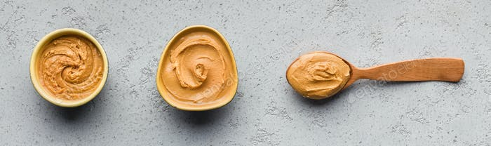 Bowls and spoon with peanut butter